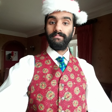 I am wearing my new Christmas waistcoat, which I made this summer.
