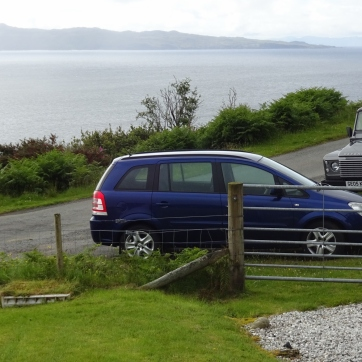 Hills across the bay in Sleat visible over the top of our hire car